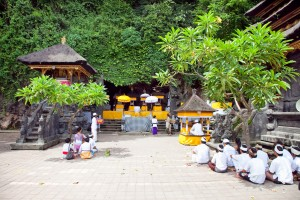 PURA GOA LAWAH, BALI, INDONESIA :JANUARY 25: People praying at holy cave temple Pura Lawah during the religious ceremony on January 25, 2012 in Padangbai, Bali, Indonesia