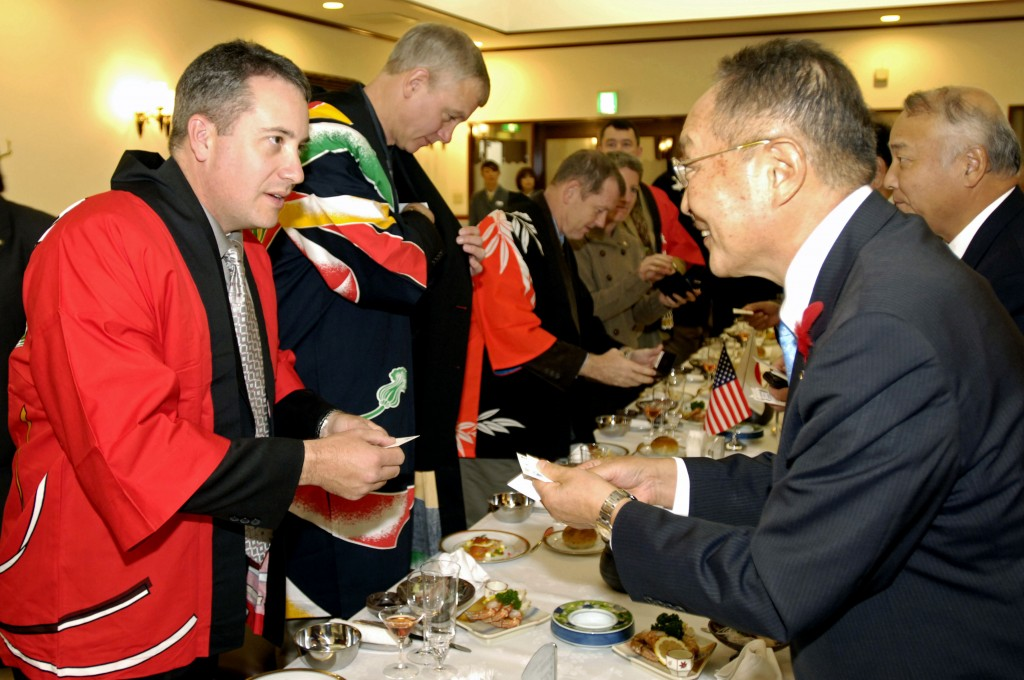 071027-N-7883G-050 MURORAN, Japan (Oct. 27, 2007) - Cmdr. Dan Dusek, commanding officer of USS Fitzgerald (DDG 62), exchanges business cards with Muroran Mayor Masashi Shingu during a reception held in the Japanese Steel Works reception hall. Fitzgerald will join USS Kitty Hawk (CV 63) and embarked Carrier Air Wing 5 to participate in an exercise with the Japan Maritime Self-Defense Force in November. U.S. Navy photo by Mass Communication Specialist Seaman Kyle D. Gahlau (RELEASED)